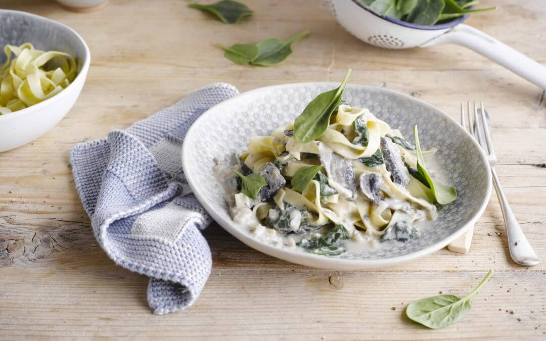 Tagliatelle met spinazie en Portobello paddenstoelen