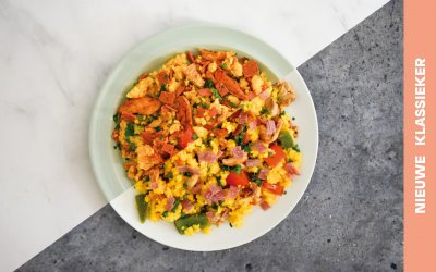 Paella met vegetarische kipstukjes en salami