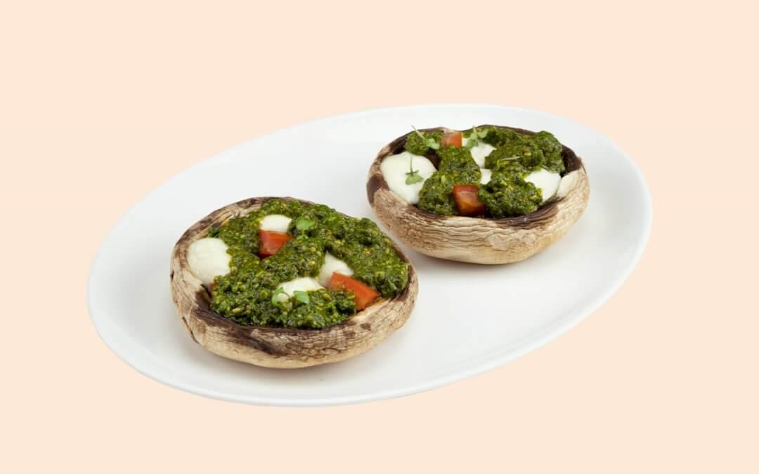 Feestpronkstuk: gevulde portobello's met basilicum pesto